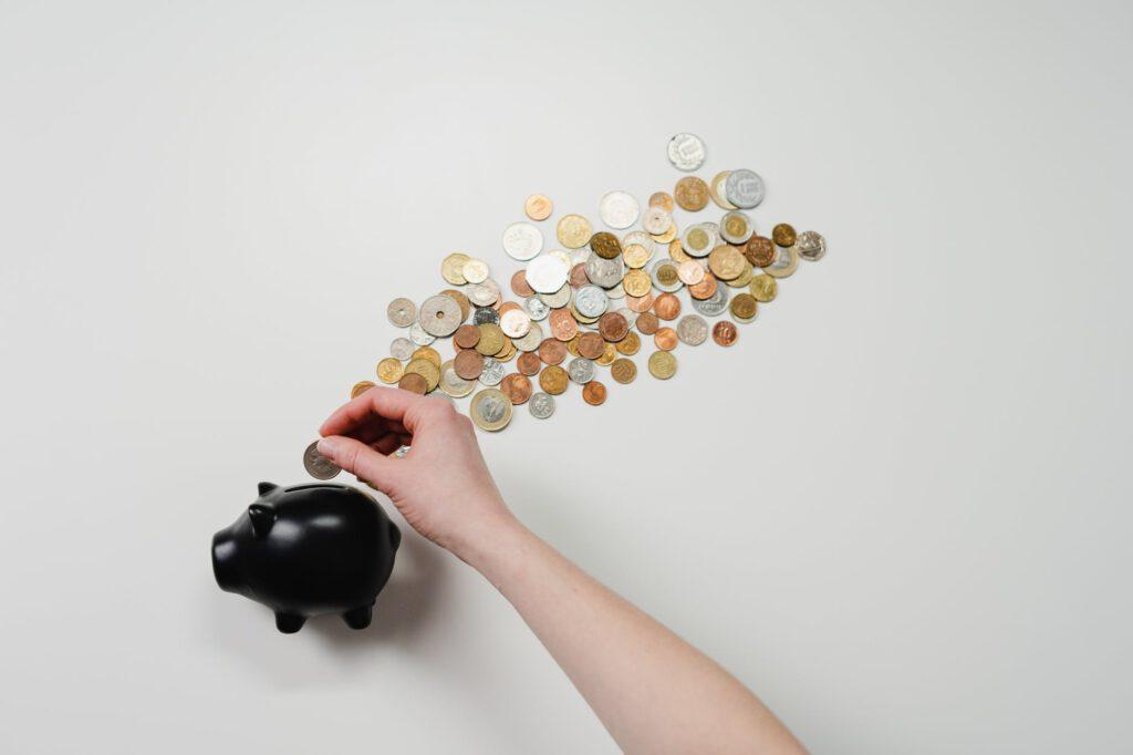 Kosten beim Wertpapierkauf, Sparschwein und Geld